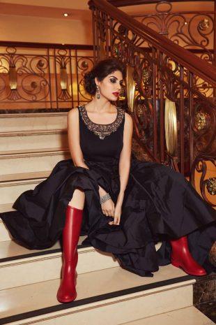 Elnaaz Norouzi Black Backless Top Sitting Stairs