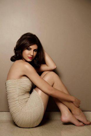 Elnaaz Norouzi Sitting on Floor with Sexy Smile