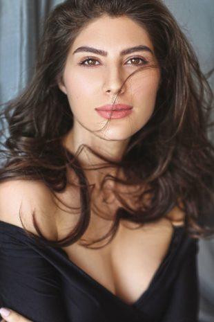 International Model Elnaaz Norouzi Cleavage Black Top